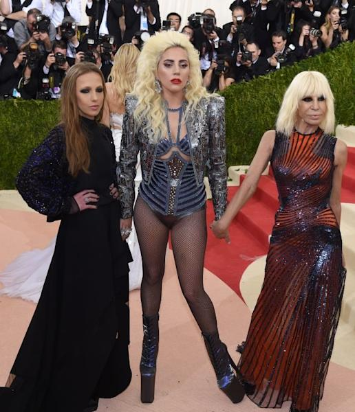 In the center, Lady Gaga caused a sensation on the red carpet at the Metropolitan Museum of Art in a corset top, a blazer and virtually nothing else except for a pair of fishnet tights. New York, May 2, 2016