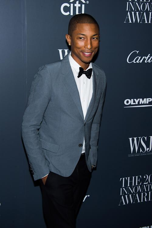 FILE - In this Nov. 6, 2013 file photo, Pharrell Williams attends the WSJ. Magazine's Innovator Awards in New York. Williams was among the top nominees for the 56th annual Grammy Awards announced Friday night, Dec. 6, 2013. (Photo by Charles Sykes/Invision/AP, File)