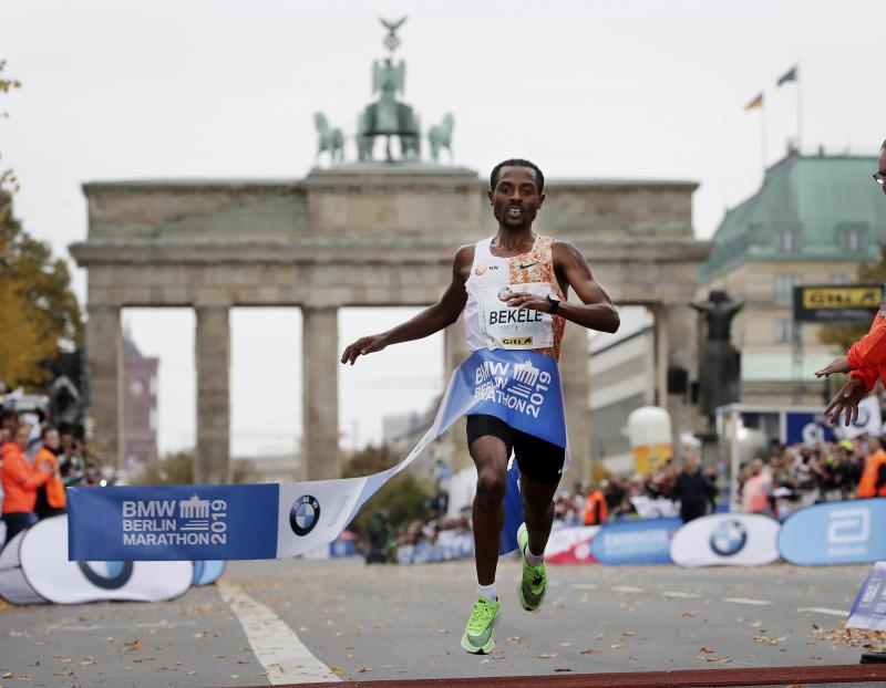 Ethiopia's Kenenisa Bekele crosses the finish line to win the 46th Berlin marathon in Berlin, Germany, Sunday, Sept. 29, 2019. (AP Photo/Michael Sohn)