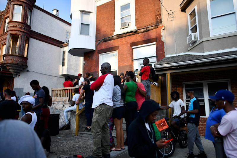 Residents anxiously watch on as the standoff unfolds. Source: Getty