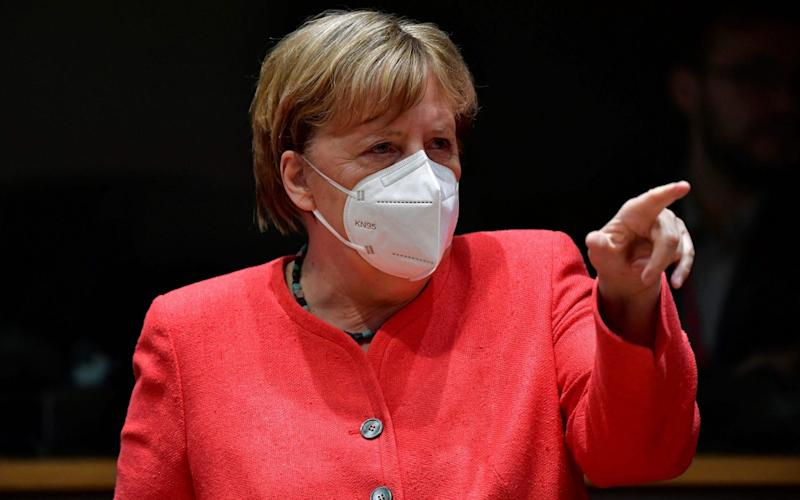 German Chancellor Angela Merkel gestures during an EU summit in Brussels on July 20, 2020, as the leaders of the European Union hold their first face-to-face summit over a post-virus economic rescue plan. (Photo by JOHN THYS / AFP) (Photo by JOHN THYS/AFP via Getty Images) - JOHN THYS/AFP