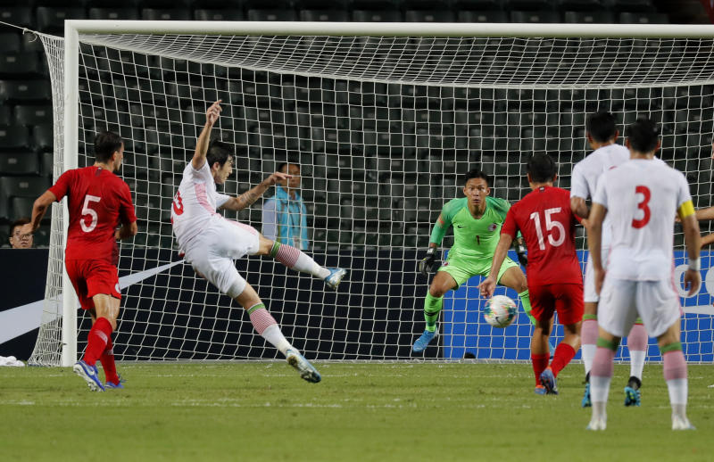 Iran's Sardar Azmoun, second left, scores a goal during the World Cup 2022 Group C qualifying soccer match between Hong Kong and Iran in Hong Kong, Tuesday, Sept. 10, 2019. (AP Photo/Kin Cheung)