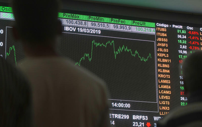 People watch the movement of The Bovespa Index on the São Paulo Stock Exchange in the central region of São Paulo, Brazil on March 19, 2019. After new records, the market should close above 100,000 points for the first time. (Photo: Bruno Rocha/Fotoarena/Sipa USA)(Sipa via AP Images)