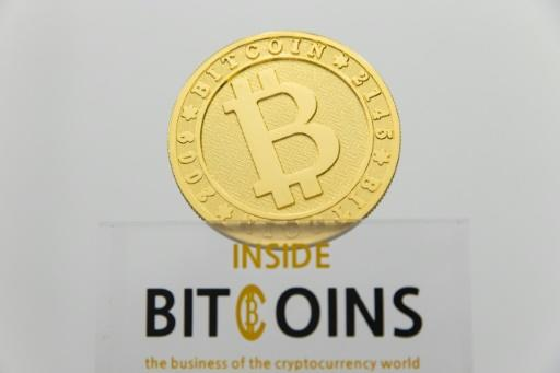 (FILES) This picture taken on January 17, 2018 shows a visual representation of the digital cryptocurrency Bitcoin, at La Maison du Bitcoin in Paris