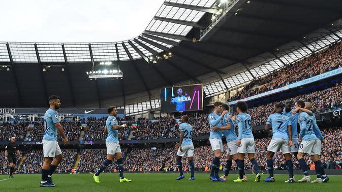 Para pemain Manchester CIty merayakan gol di Etihad Stadium. (AFP/Paul Ellis)