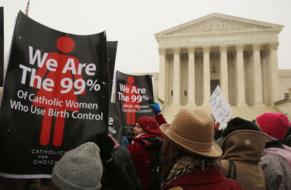 Protesters rally at steps of the Supreme Court as arguments begin today to challenge the Affordable Care Act's requirement that employers provide coverage for contraception as part of an employee's health care, in Washington