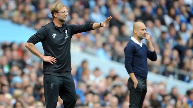 Jurgen Klopp dan Pep Guardiola. (AP Photo/Rui Vieira)