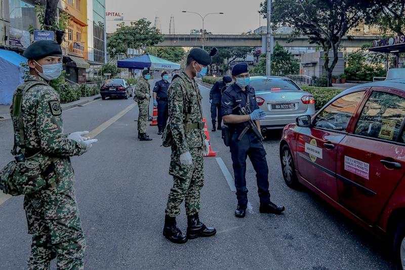 Malaysian Armed Forces and police personnel man a roadblock in Kuala Lumpur March 25, 2020. — Picture by Firdaus Latif