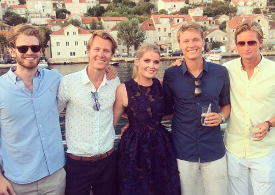 Lady Kitty Spencer poses with her younger brother Louis far left on holidays.