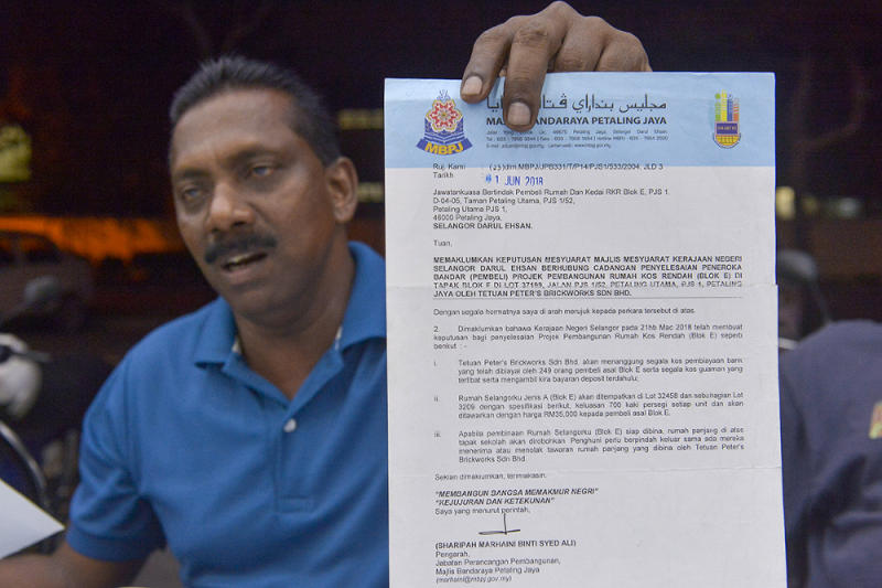 PJS1 Block E low-cost homes and shop buyers action committee chairman M. Sugumaran said house buyers have been waiting for 15 years for their homes February 28, 2019. — Picture by Mukhriz Hazim