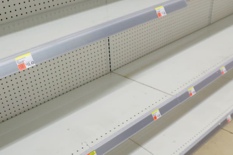 FILE PHOTO: Toilet roll shelves are seen empty in a store in Manhattan as more cases of coronavirus were confirmed in New York City