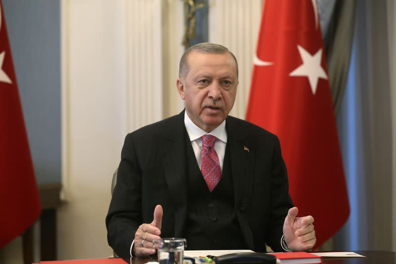 Turkish President Erdogan speaks to members of his ruling AKP during a video conference call in Ankara