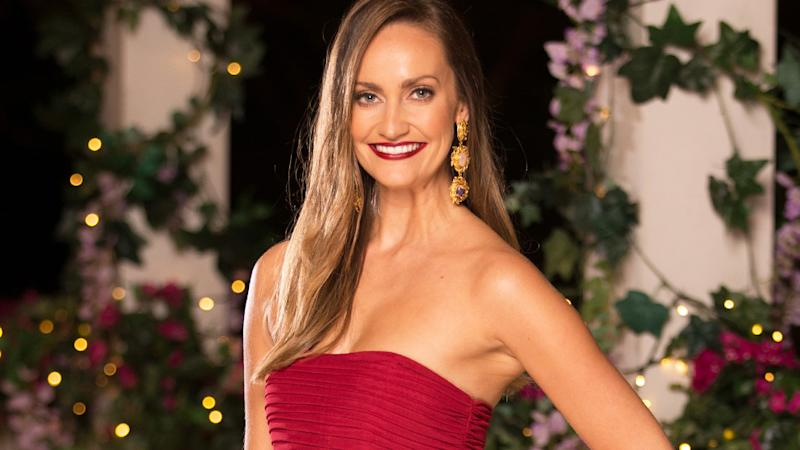 A photo of Emma Roche wearing a red gown on set of The Bachelor Australia 2019.