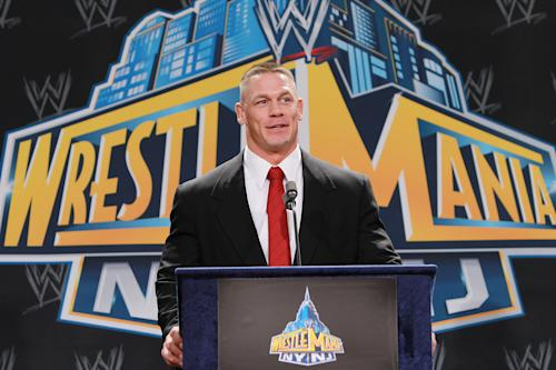 "In this Thursday, Feb. 16, 2012 photo, World Wrestling Entertainment personality John Cena speaks at a news conference in East Rutherford, N.J., to announce that MetLife Stadium will host WrestleMania XXIX on April 7, 2013. WWE is joining with New York Mayor Michael Bloomberg, New Jersey Gov. Chris Christie, Hollywood celebrities and professional athletes to launch Superstars for Sandy Relief. Fans can bid on hundreds of items in an online auction, including attending a NASCAR race with Cena, meeting Tyra Banks on the set of ""America's Next Top Model,"" or pitching entrepreneurial ideas to Mark Cuban. The auction begins Monday, March 25, 2013, and closes April 9 on charitybuzz.com. (AP Photo/StarPix, Dave Allocca)"