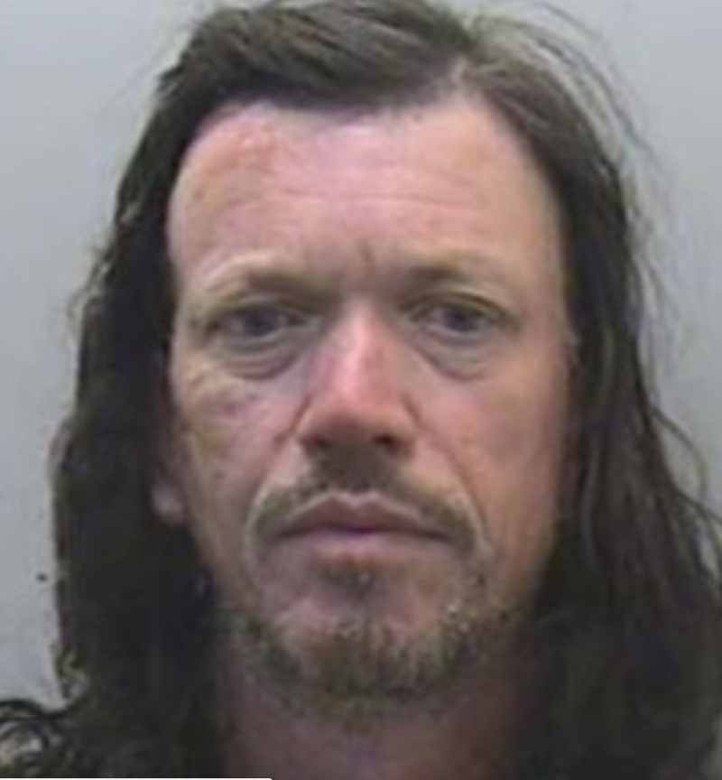 Tristan Morgan pictured with long hair and a goatee.