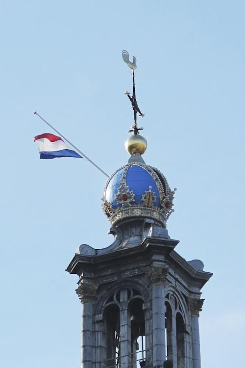 A flag is flying at half-staff at Westertoren or Wester Tower in Amsterdam, Friday, Aug. 16, 2013. Members of the Dutch royal family and a small collection of friends are attending a private funeral for Prince Friso, who died this week due to complications from a 2012 skiing accident. He died on Monday, aged 44. Flags are flying at half-staff on official buildings around the country, and thousands of Dutch people have sent messages of condolences via social media. Friso is survived by his wife, Princess Mabel, and two young daughters. (AP Photo/Margriet Faber)