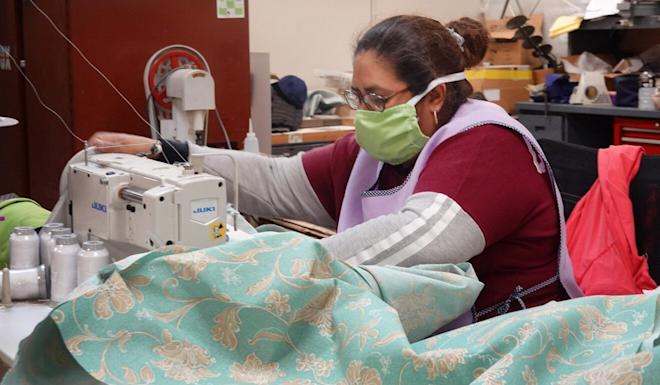 A worker in Alsip, Illinois, sews medical gowns and other personal protective equipment. Photo: Getty Images/AFP