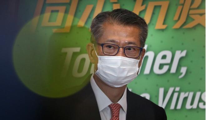 Financial Secretary Paul Chan says people need to avoid unnecessary trips around the city. Photo: May Tse