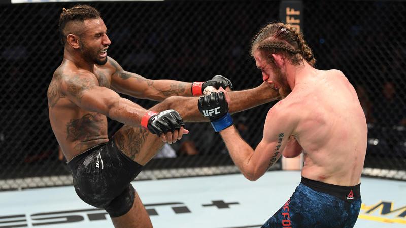 Mike Davis, pictured here kicking Thomas Gifford at UFC Tampa.