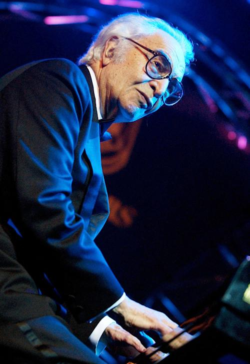 FILE - Nov. 7, 2002 file photo shows U.S. jazz legend Dave Brubeck performing on the Mustermesse stage at the AVO Session in Basel, Switzerland. Brubeck, a pioneering jazz composer and pianist died Wednesday, Dec. 5, 2012 of heart failure, after being stricken while on his way to a cardiology appointment with his son. He would have turned 92 on Thursday. (AP Photo/Keystone, Markus Stuecklin, file)