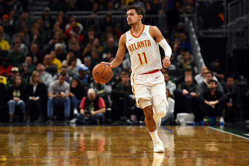 MILWAUKEE, WISCONSIN - JANUARY 04: Trae Young #11 of the Atlanta Hawks handles the ball during a game against the Milwaukee Bucks at Fiserv Forum on January 04, 2019 in Milwaukee, Wisconsin. NOTE TO USER: User expressly acknowledges and agrees that, by downloading and or using this photograph, User is consenting to the terms and conditions of the Getty Images License Agreement. (Photo by Stacy Revere/Getty Images)