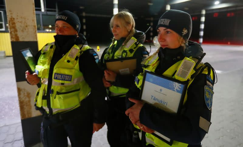 Estonian police and border guard officers hold diplomas at border crossing point in Ikla