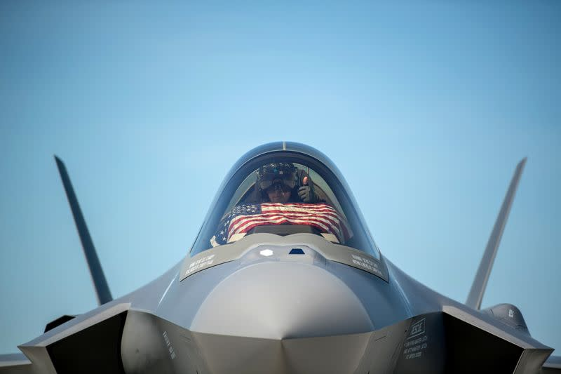 An F-35 pilot prepares for take off from the Vermont Air National Guard Base with the flag of the United States