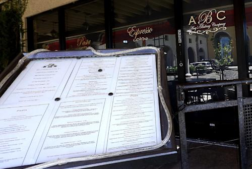"This Monday, June 3, 2013 photo shows Amy's Baking Company in Scottsdale, Ariz., with the menu displayed outside the restaurant. The restaurant temporarily closed after their ""Kitchen Nightmares"" episode aired. The episode of ""Kitchen Nightmares"" drew more than a million viewers on YouTube, and restaurateur Amy Bouzaglo's vitriolic rants became popular fodder on Twitter and Facebook. Bouzaglo announced she is shopping around her own reality TV show. (AP Photo/Ross D. Franklin)"