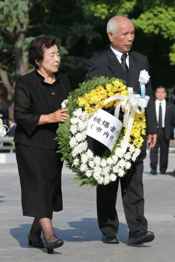 Representatives of atomic bomb survivors offer a wreath at the 73rd anniversary memorial service