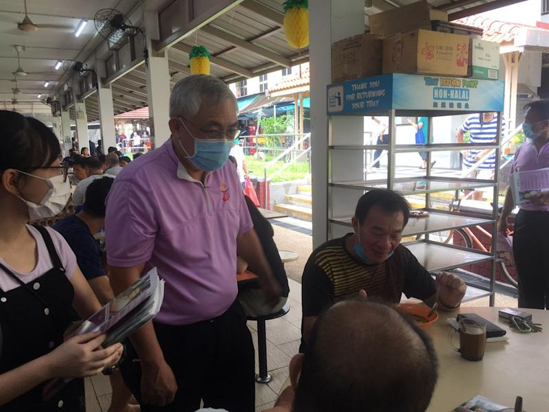 People's Power Party founder Goh Meng Seng meeting residents at MacPherson Market & Food Centre on Saturday morning (27 June). (Photo: Christalle Tay/Yahoo News Singapore)