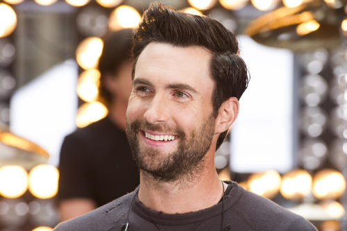 """FILE - In this June 14, 2013 file photo, Maroon 5 lead singer Adam Levine appears on NBC's """"Today"""" show in New York. Levine's representative confirmed Tuesday, July 16, 2013, that the Maroon 5 singer is engaged to model Behati Prinsloo. The couple started dating last year. The 34-year-old singer proposed to 24-year-old Prinsloo in Los Angeles this weekend. Levine is also a judge on the NBC singing series """"The Voice."""" (Photo by Charles Sykes/Invision/AP, File)"""