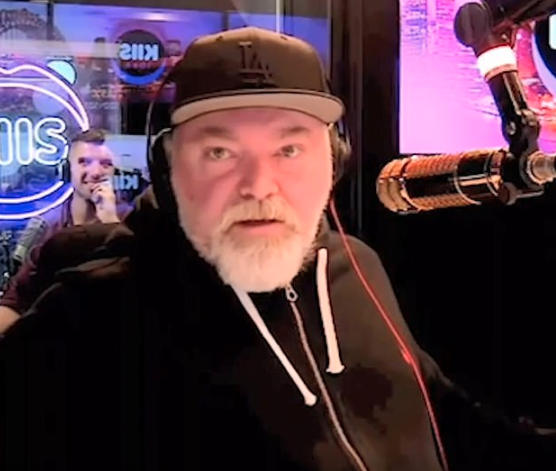 Kyle Sandilands has apologised as protestors call for his resignation