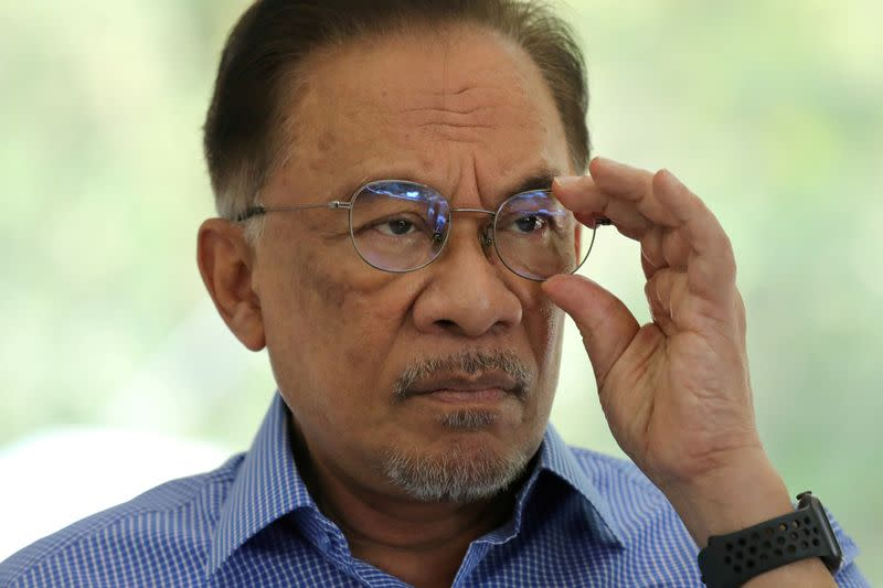 Malaysia's Anwar meets king to prove majority support for PM bid