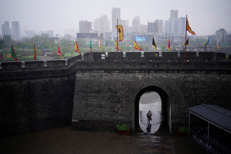 A man walks through an ancient city wall in Jingzhou, after the lockdown was eased in Hubei province