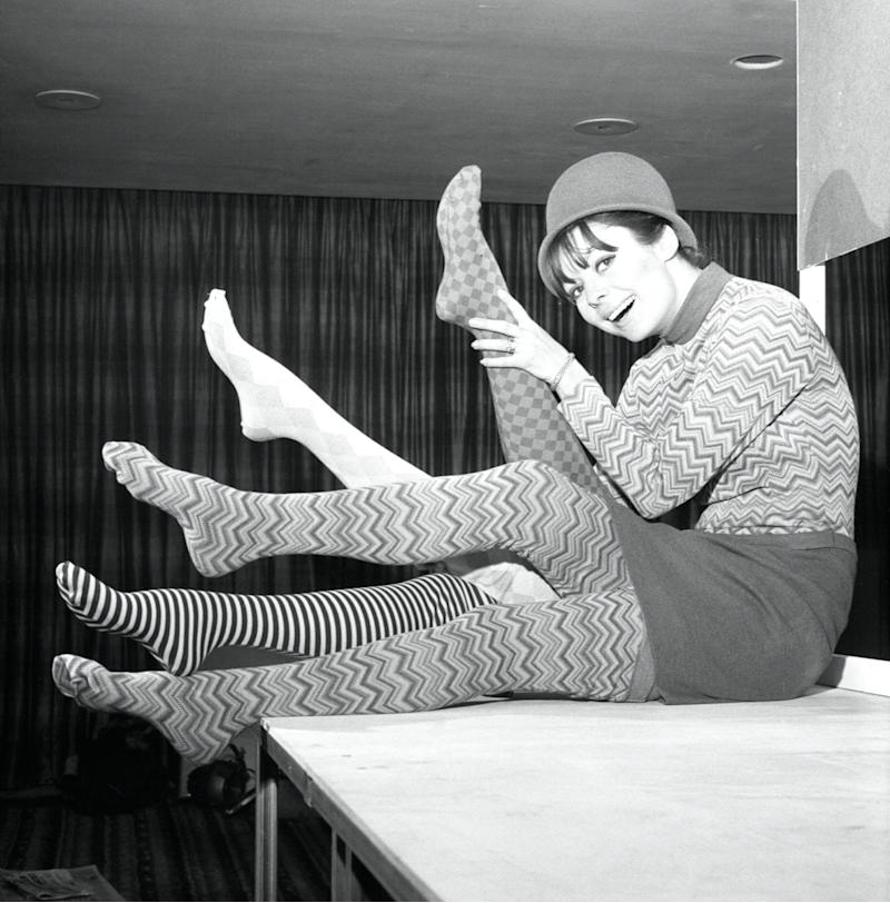 black and white photo of woman in 1960s wearing patterned tights