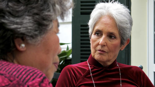 In this April 6, 2013 photo, Joan Baez listens to former staff of the Metropole Hanoi discuss their memories of working at the hotel in 1972 in Hanoi, Vietnam. The folk singer and social activist visited Vietnam recently for the first time since she came to the country in December 1972 as part of an American peace delegation. (AP Photo/Dinh Hau)