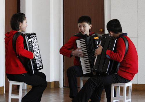 "In this Feb. 25, 2012 photo, students rehearse with accordions in a practice room at the Kumsong school in Pyongyang, North Korea. A group from the school became an Internet sensation with their accordion version of 1980's pop group A-ha's ""Take on Me."" (AP Photo/Kim Kwang Hyon)"