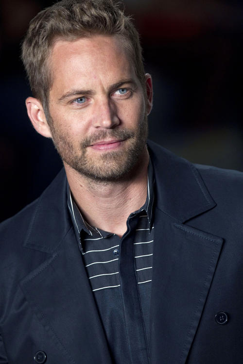 "File-This March 21, 2013 file photo shows actor Paul Walker wearing a creation from the Colcci summer collection at Sao Paulo Fashion Week in Sao Paulo, Brazil. A publicist for actor Walker says the star of the ""Fast & Furious"" movie series has died in a car crash north of Los Angeles. He was 40. Ame Van Iden says Walker died Saturday, Nov. 30, 2013. No further details were released. (AP Photo/Andre Penner, File)"