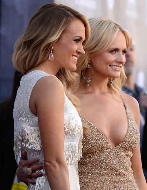 Carrie Underwood, left, and Miranda Lambert arrive at the 49th annual Academy of Country Music Awards at the MGM Grand Garden Arena on Sunday, April 6, 2014, in Las Vegas. (Photo by Al Powers/Powers Imagery/Invision/AP)