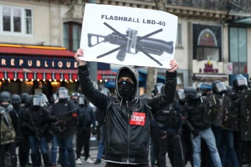 The yellow vest movement and rights groups want the LBD launchers banned; some French MPs are pushing to ban demonstrators from wearing masks