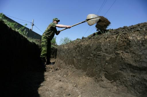 "Armed with spades, saws and hammers, a separatist battalion build what they call a ""second fortified line"" for the armed forces of the self-proclaimed Donetsk People's Republic"