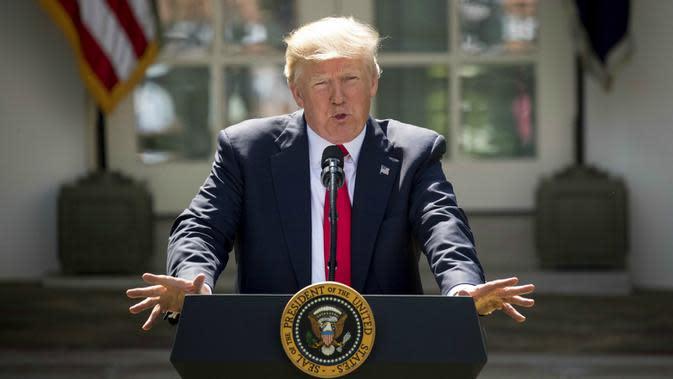 Donald Trump saat mengumumkan hengkangnya AS dari Kesepakatan Paris di Gedung Putih (1/6/2017) (AP Photo/Andrew Harnik)