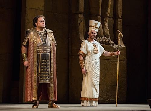 """In this Nov. 15, 2012 photo provided by the Metropolitan Opera, Marco Berti, left, performs as Radames and Stefan Kocan as Ramfis in Verdi's """"Aida,"""" during a dress rehearsal at the Metropolitan Opera in New York. (AP Photo/Metropolitan Opera, Marty Sohl)"""