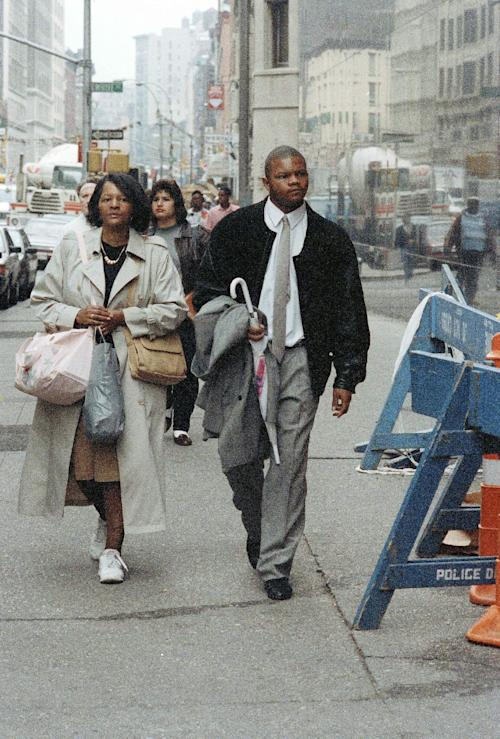 FILE - In this Oct. 22, 1990 file photo, Kevin Richardson arrives at the State Supreme Court in Manhattan with his mother, Grace Lovey, for the start of his trial in the Central Park jogger case. Richardson and four other teenage boys maintained their innocence as they grew up behind bars after being convicted in the rape and brutal beating of the woman jogger. Their convictions were eventually tossed out by a judge when new evidence surfaced linking someone else to the crime. But their legal battle goes on: A $250 million federal lawsuit against police and prosecutors has been pending nearly a decade, with no resolution in sight. (AP Photo/Mike Albans, File)