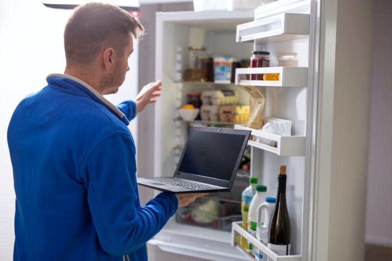 Man reaching into refrigerator
