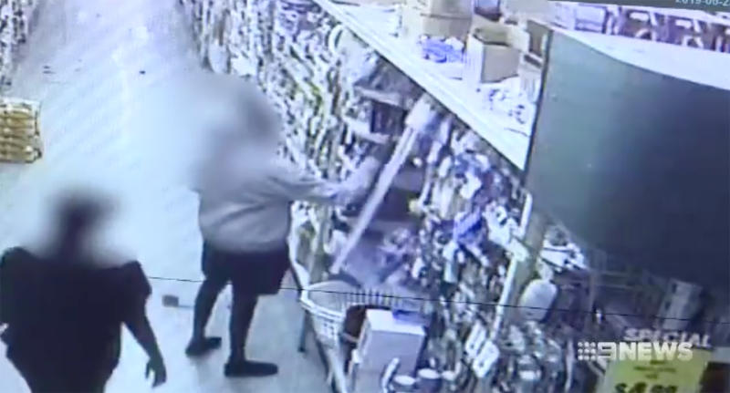 Two members of the group can be seen taking broomsticks from the supermarket shelves.