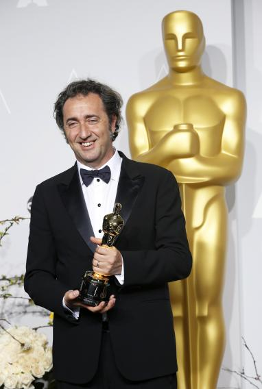 "Paolo Sorrentino, director of Italian film ""The Great Beauty"" poses with his award for best foreign language film at the 86th Academy Awards in Hollywood, California"