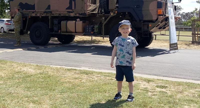 Darragh, 3, smiles next to an army vehicle. His family have appealed to Australia's Immigration Minister and Home Affairs Minister Peter Dutton for help.