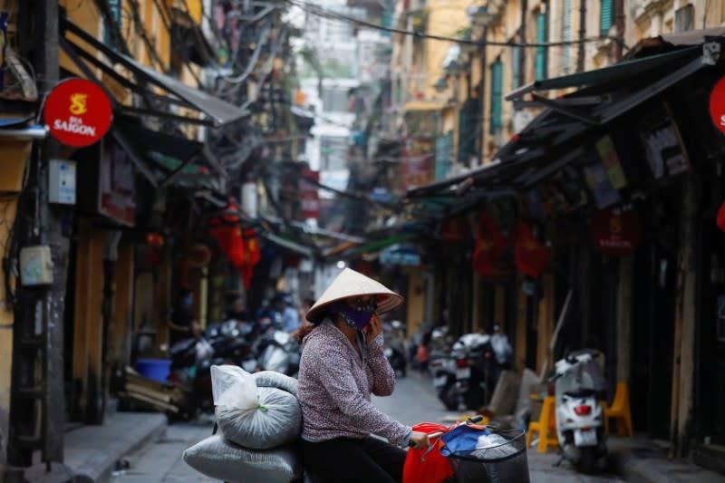 Vietnam bans big gatherings, cuts flights in coronavirus battle
