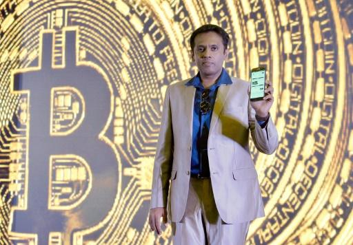 (FILES) In this file photo taken on January 16, 2017 Indian Belfrics CEO Praveen Kumar poses for a photograph at a press conference during the launch of the firms's Indian Bitcoin exchange operations in Bangalore on January 16, 2017. From its birth in an anonymous paper in 2008 to growth into one of the world's most volatile and closely watched financial instruments in 2018, bitcoin has lived through a tumultuous first 10 years
